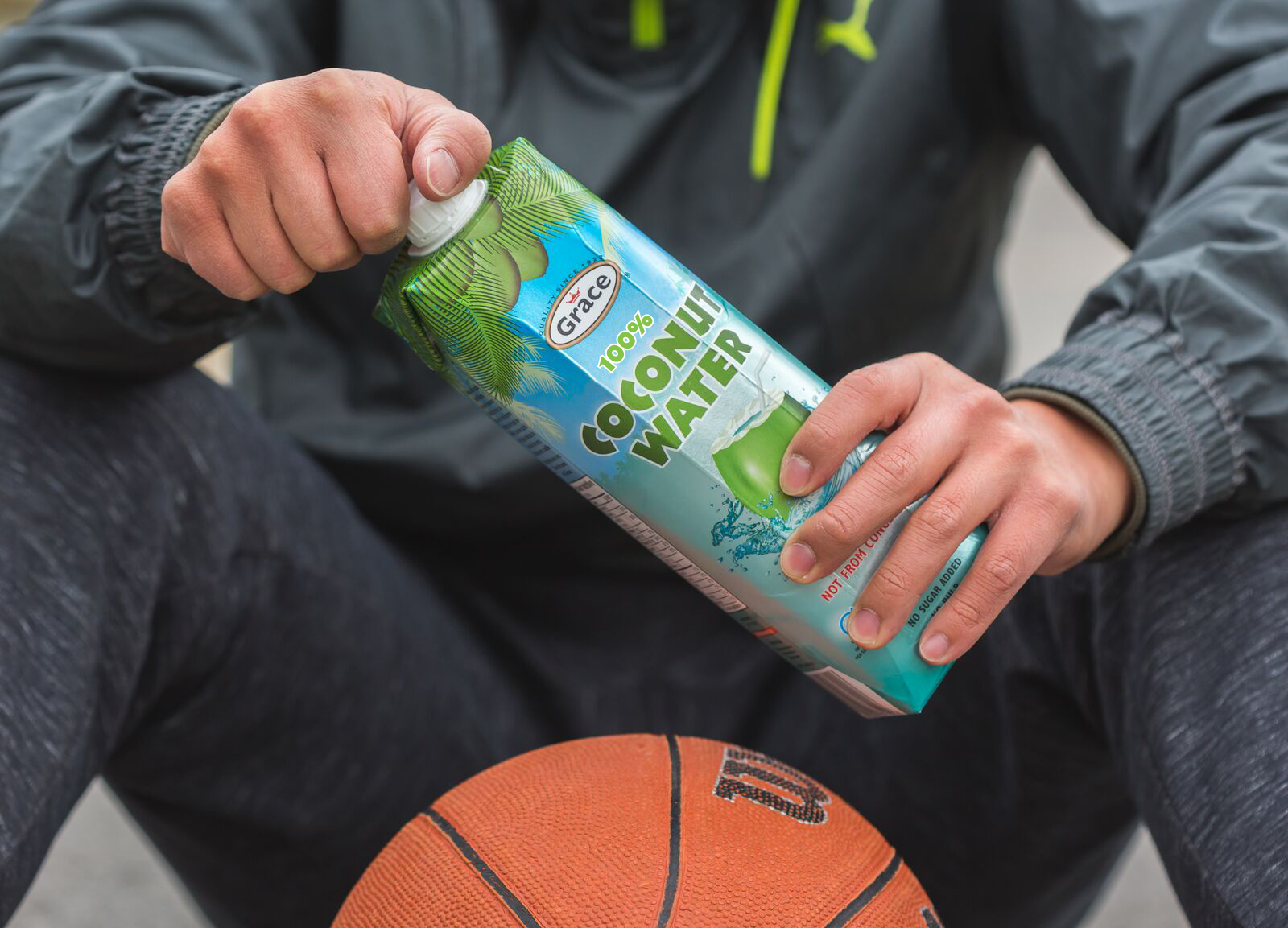 basketball player drinking coconut water